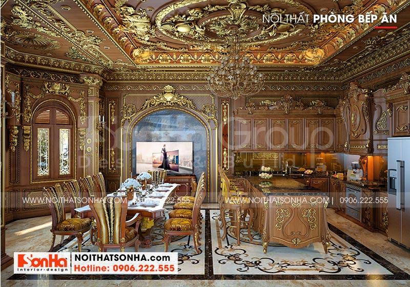 Chất liệu gỗ được sử dụng trong thiết kế nội thất cùng cách trang trí hoa văn phào chỉ tinh tế mang đến không gian phòng bếp ăn ấm cúng cho ngôi biệt thự